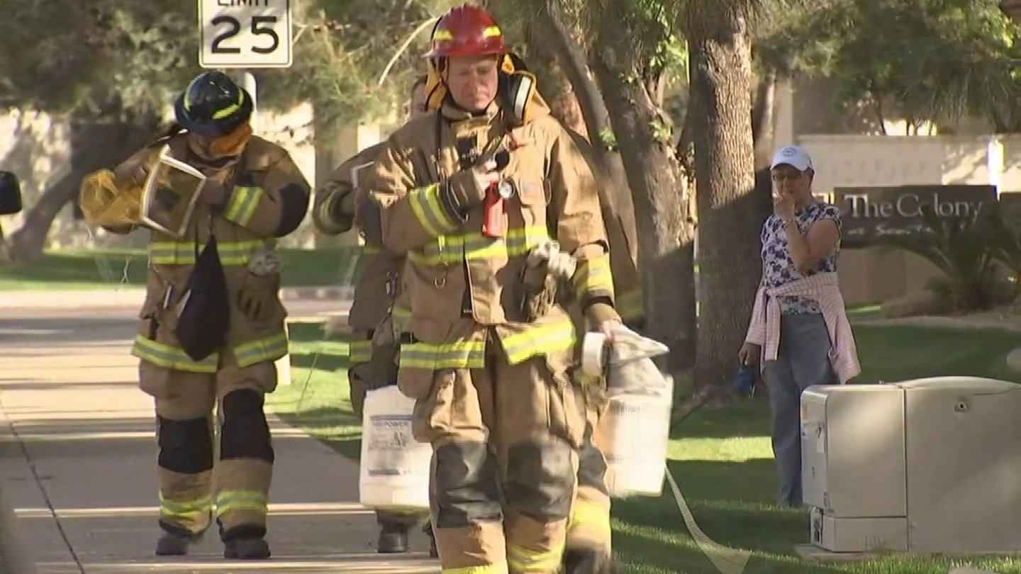 Firefighters said there was a a large swarm of aggressive bees. (Source: KPHO/KTVK)