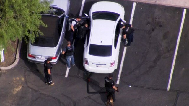 When police secured the scene and deemed it safe, they approached the suspect's vehicle. (Source: KPHO/KTVK)