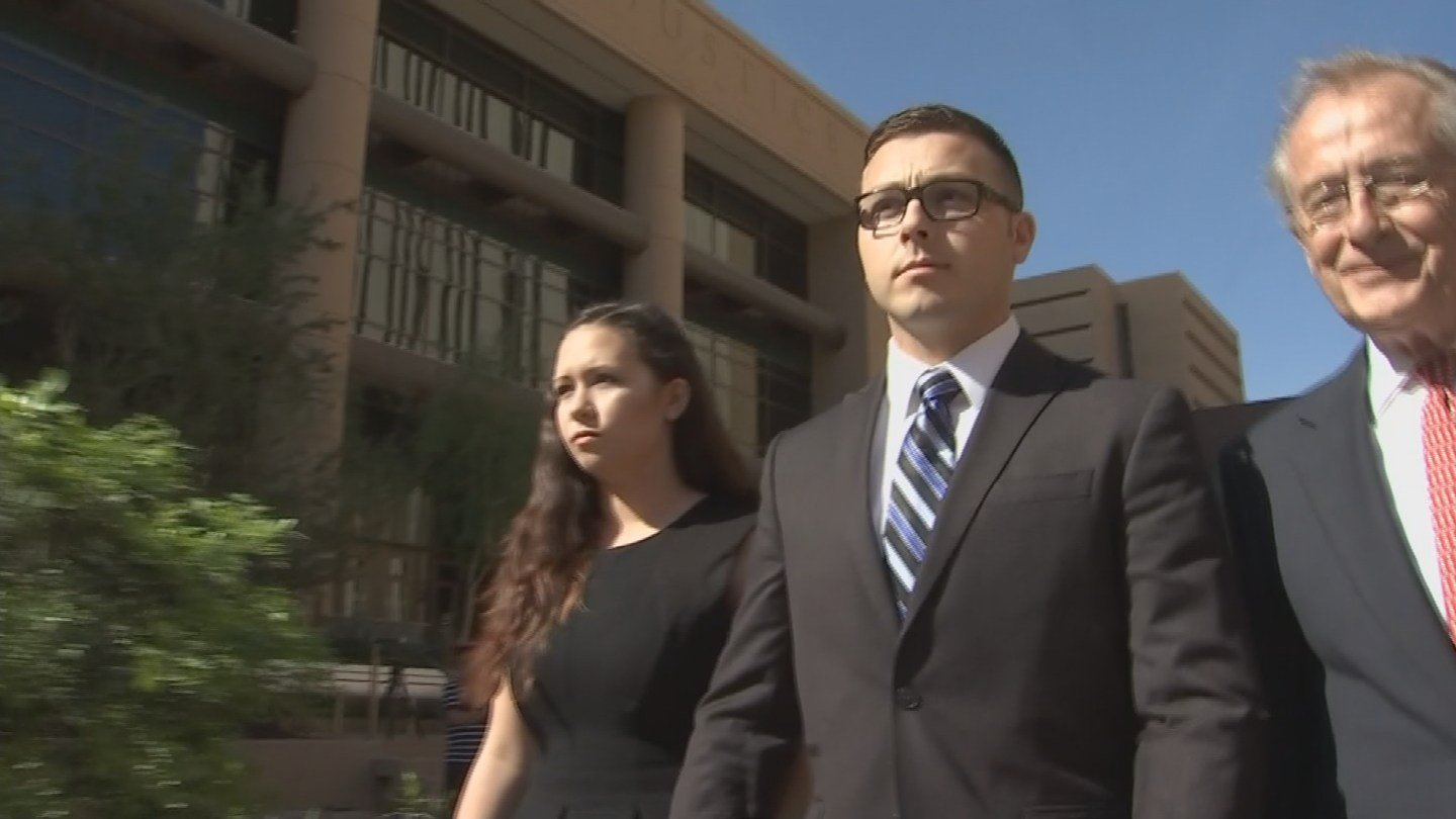 Officer Philip Mitchell Brailsford leaves court after a hearing on March 15, 2016 (Photo source: KPHO/KTVK)