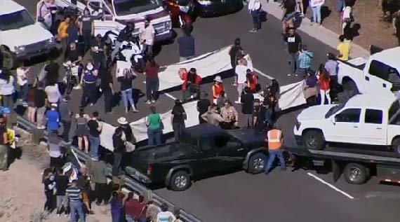 Anti-Trump protesters block a street leading into Fountain Hills. (Source: KPHO/KTVK)