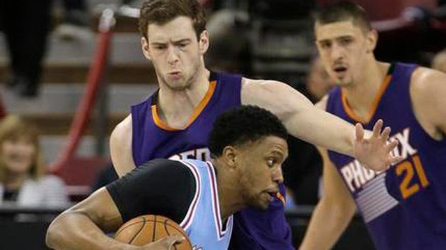 Sacramento Kings forward Rudy Gay, left, drives against Phoenix Suns forward Jon Leuer during the first half of an NBA basketball game Friday in Sacramento. (AP Photo/Rich Pedroncelli)
