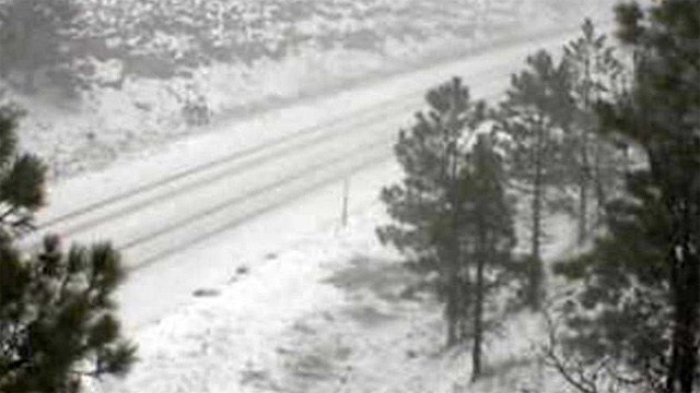 At 8:40 a.m. Tuesday, snow was accumulating on SR 87 at Clints Well (milepost 291.4). (Source: ADOT)