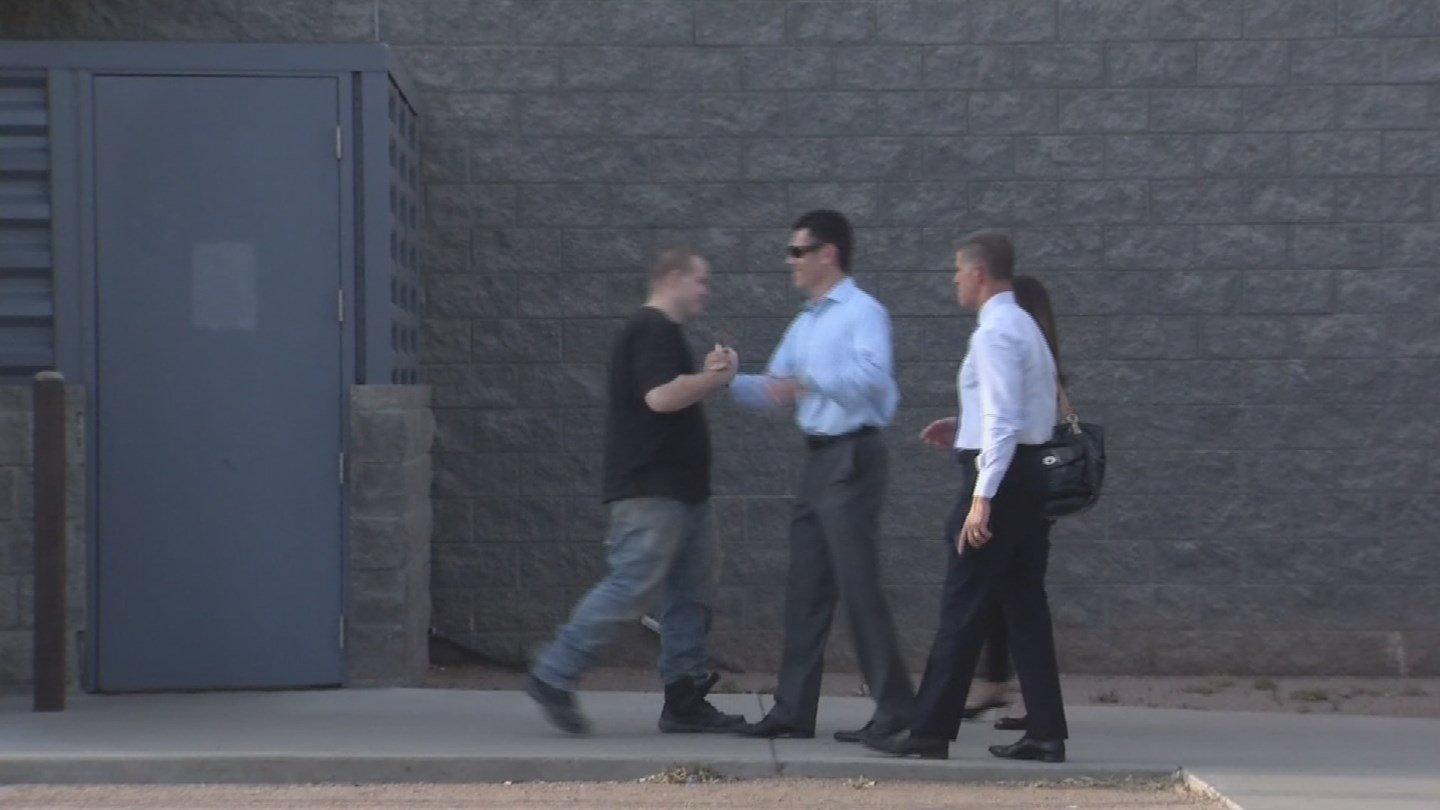 Leslie Merritt Jr. greeted his defense team after being released from jail Tuesday (Source: KPHO/KTVK)