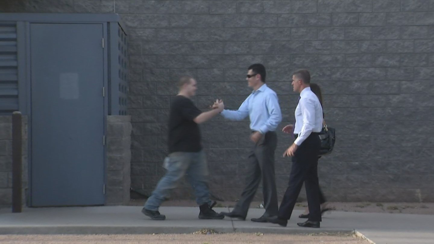 Freeway shooting suspect Leslie Merritt Jr. greeted by his lawyers after being released from jail on April 19, 2016 (Source: KPHO/KTVK)