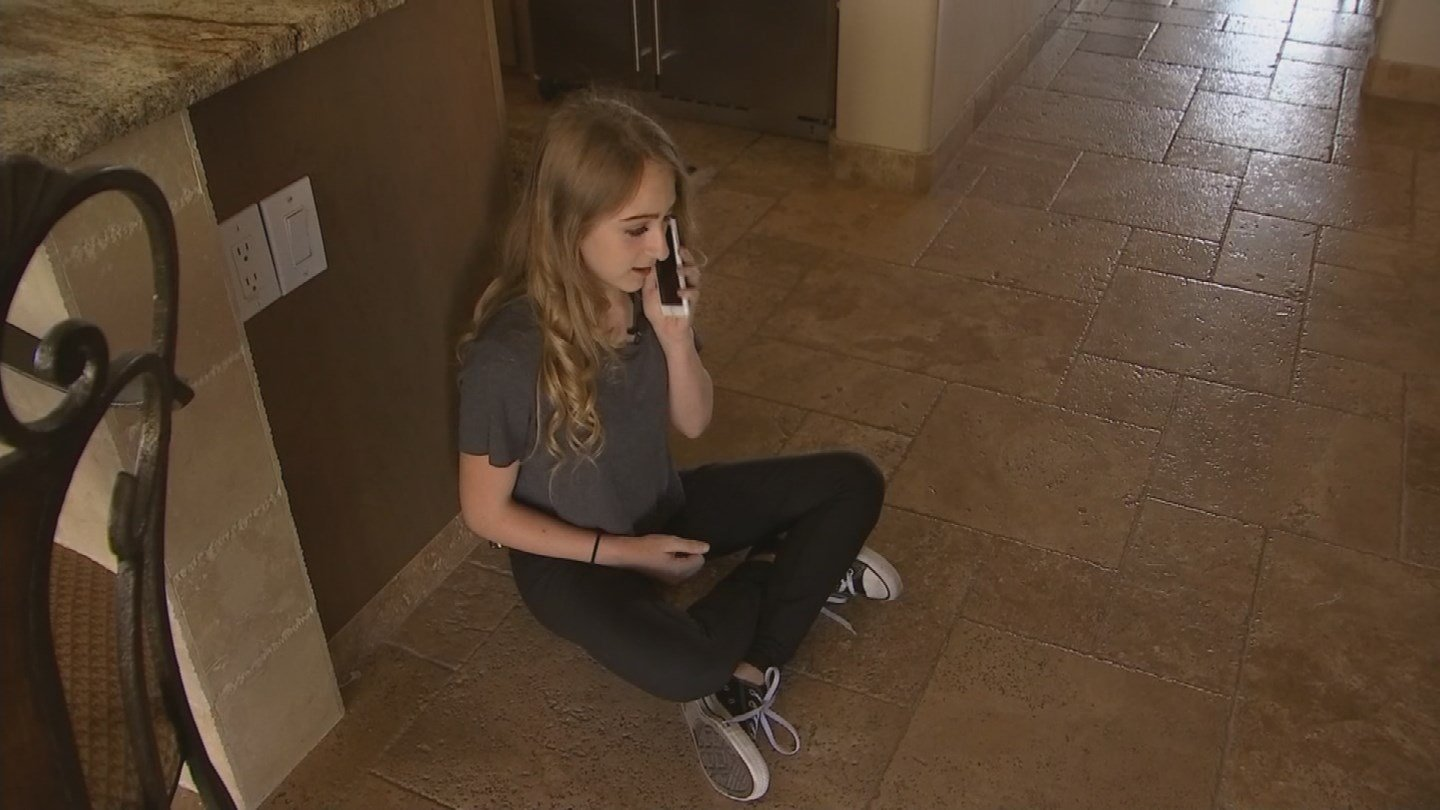 Caty Creed hid in the kitchen, calling her parents and the police. (Source: KPHO/KTVK)