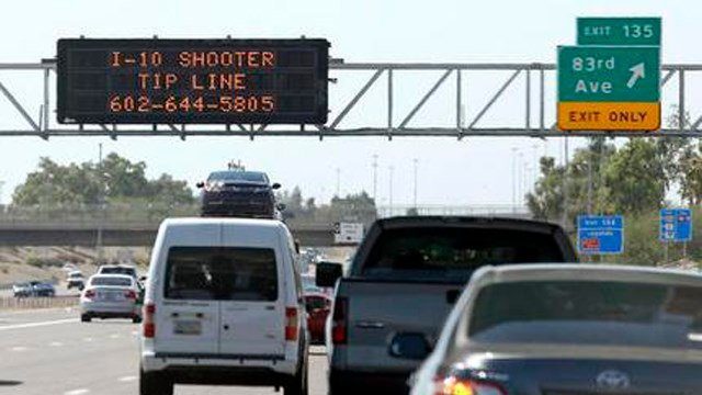 In this Sept. 11, 2015 file photo, a sign displays a shooter tip line above Interstate 10 in Phoenix. (SOurce: AP/Ross D. Franklin)