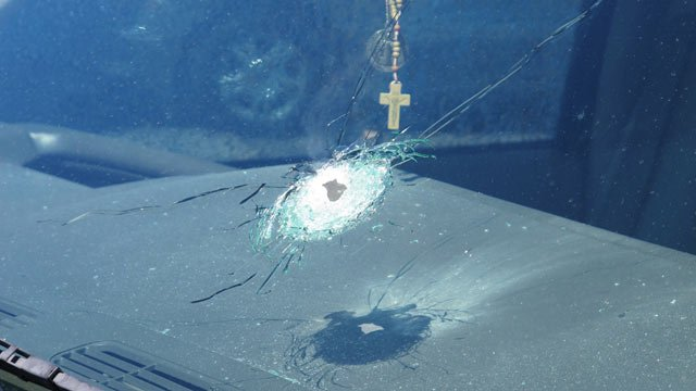 A bullet from one of the freeway shootings shattered this windshield. (Source: (Source: KPHO/KTVK)