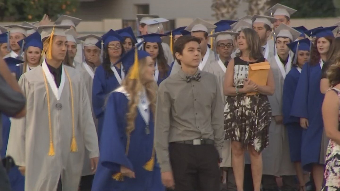 Dwyer led his class as student body president during graduation but had to sit in the stands after. (Source: KPHO/KTVK)