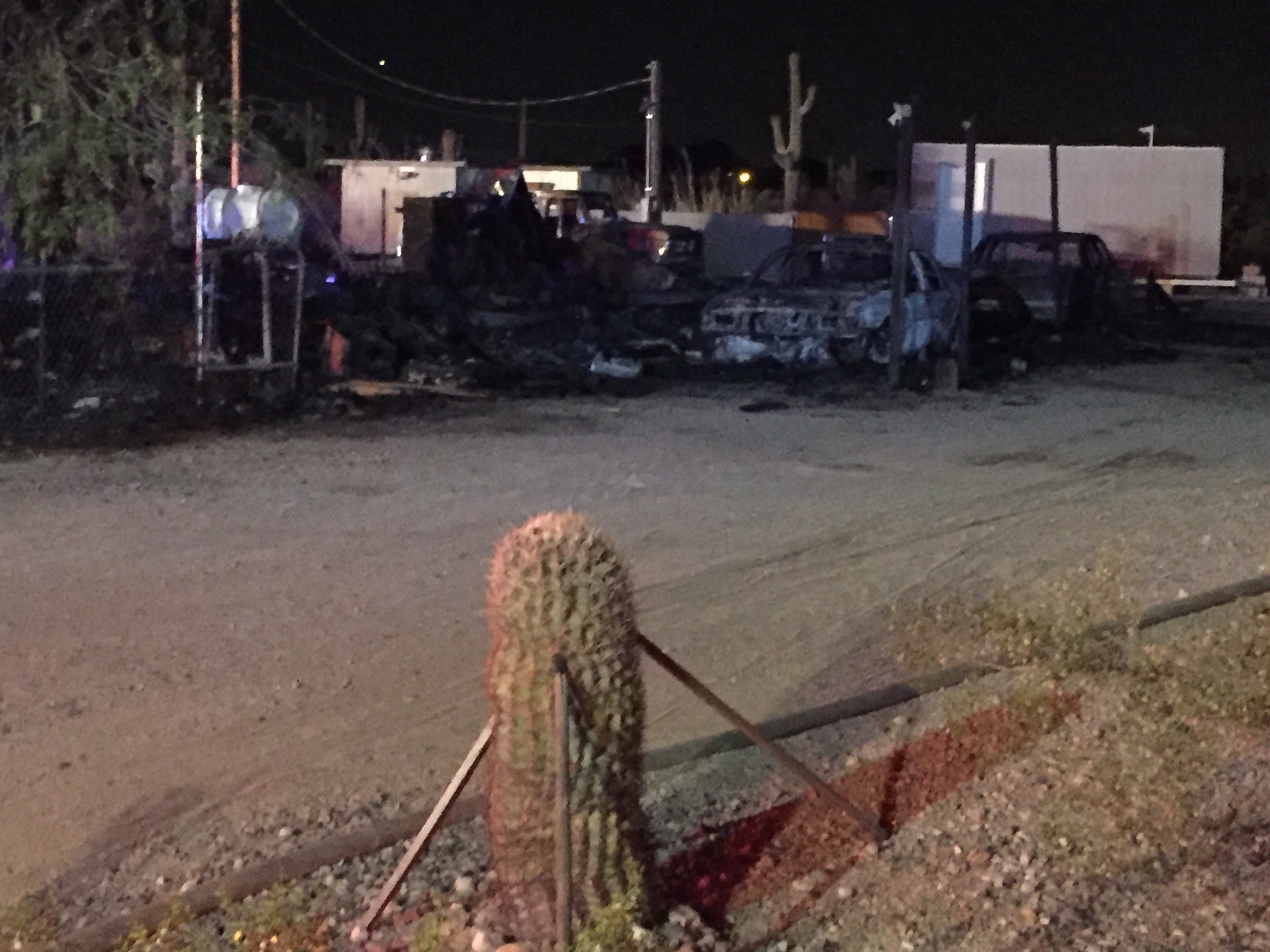 A fire seriously burned a mobile home and cars in Apache Junction. (Source: KPHO/KTVK)