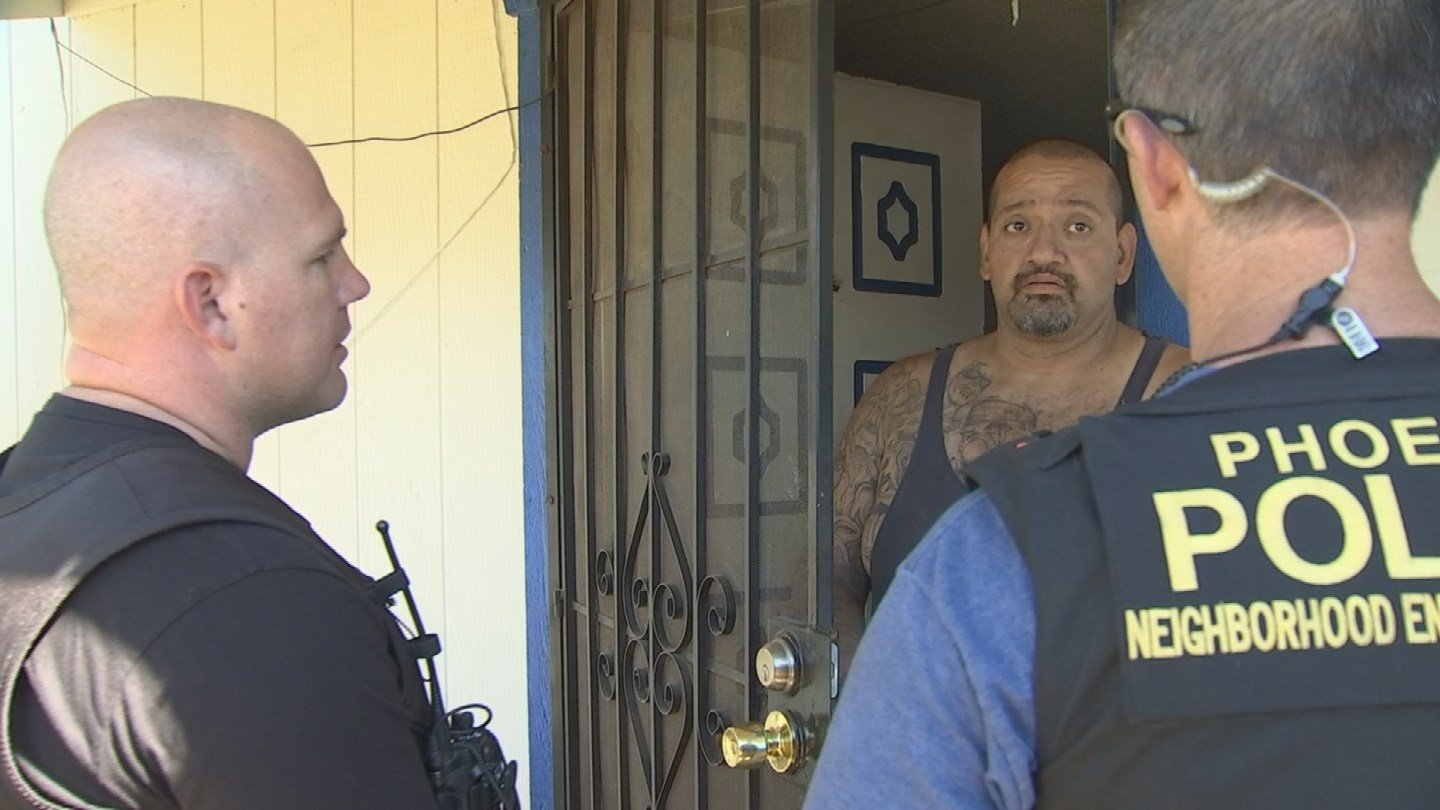 Officers went door to door Tuesday afternoon to talk to residents about four recent unsolved homicides and hand out Silent Witness fliers. (Source: KPHO/KTVK)
