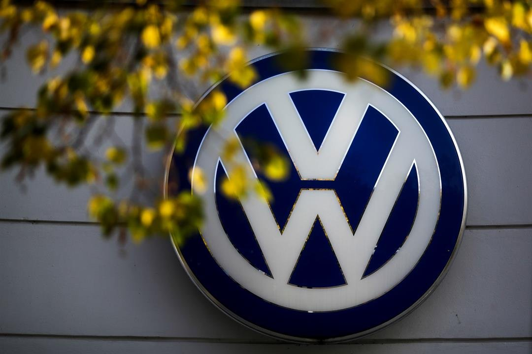In this Oct. 5, 2015, file photo, the VW sign of Germany's Volkswagen car company is displayed at the building of a company's retailer in Berlin. (Source: AP Photo/Markus Schreiber, File)