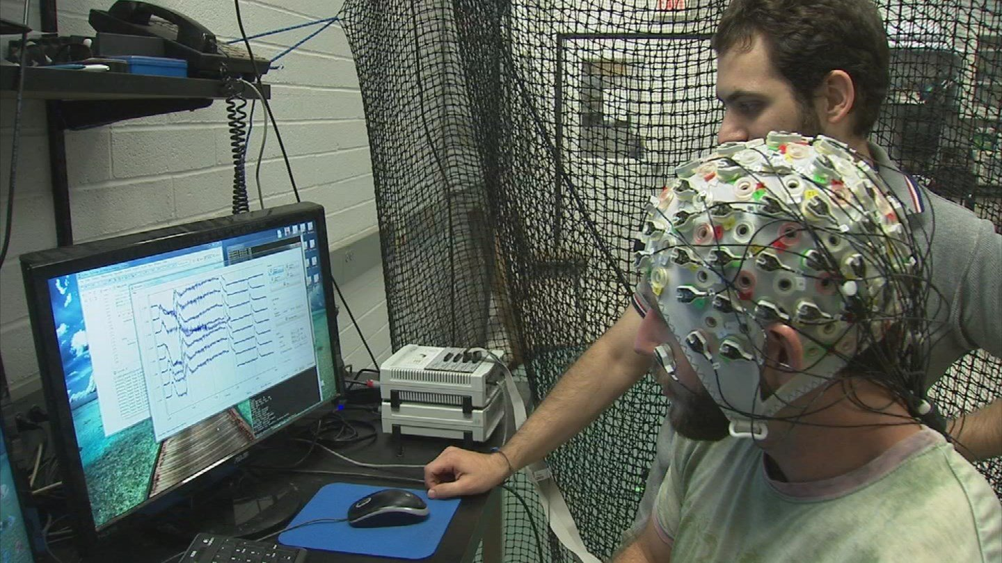 An ASU researcher has developed a system to control multiple robots with the human brain. (Source: KPHO/KTVK)