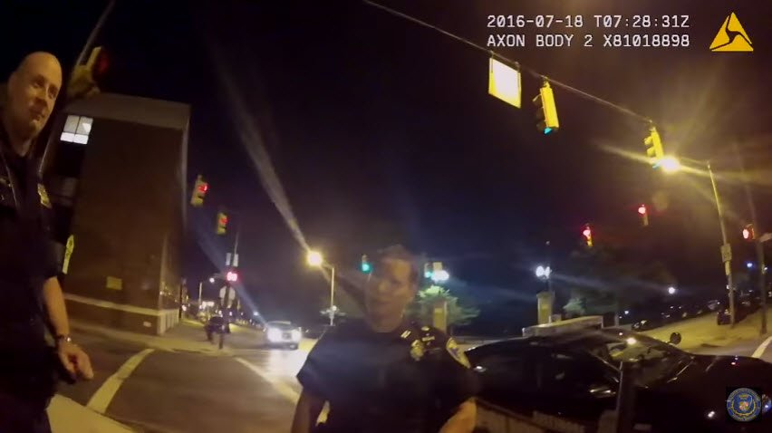This still image from a Baltimore police officer's body cam shows two fellow officers seconds before a driver playing Pokemon Go slammed into his squad car. (Source: Baltimore Police Department/CNN)