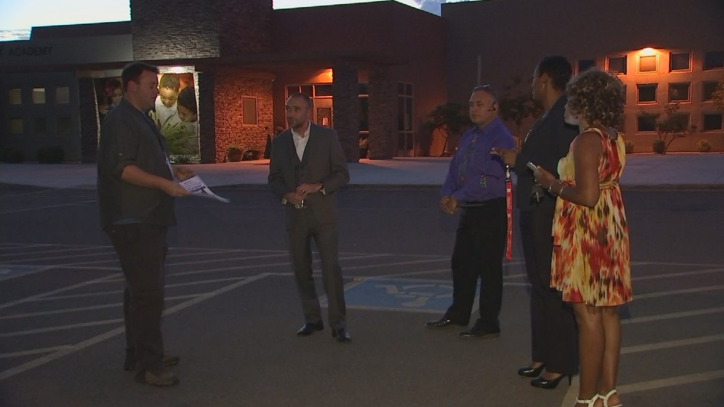 School administrators passed out fliers on Tuesday. (Source: KPHO/KTVK)
