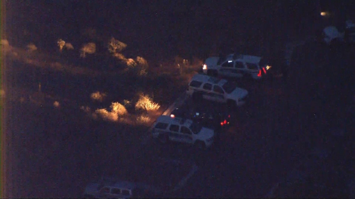 Police remained on the scene hours after the boy was airlifted to the hospital. (Source: KPHO/KTVK)