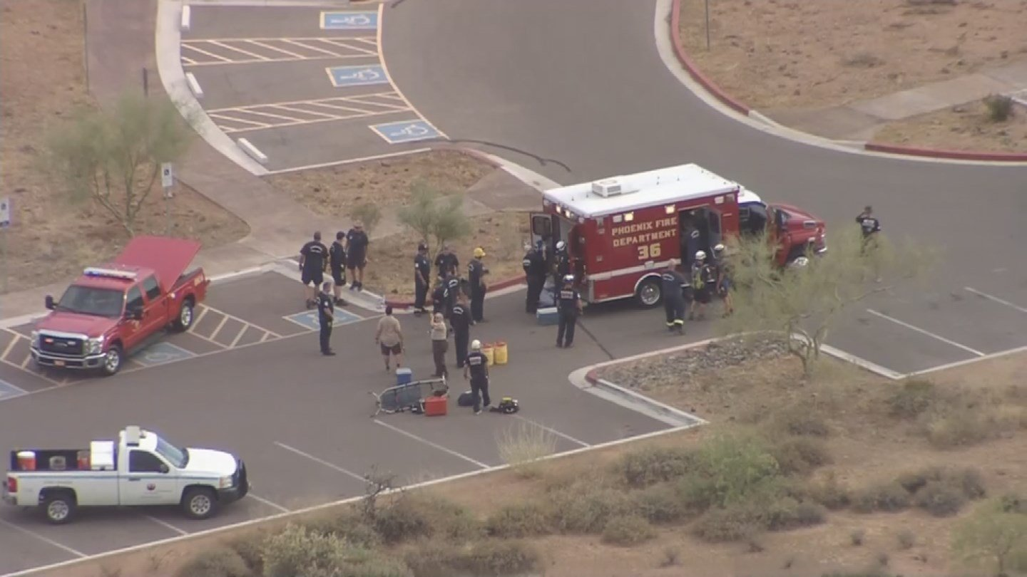 Rescue crews rush to assist the boy who had collapsed during a hlke. (Source: KPHO/KTVK)