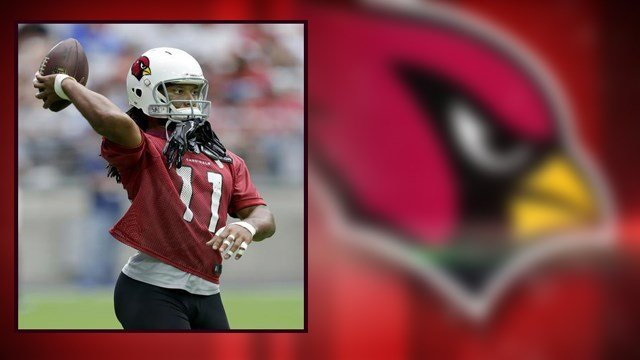Arizona Cardinals' Larry Fitzgerald throws the ball during practice at the NFL football team's training camp, Friday, July 29, 2016, in Glendale. (AP Photo/Matt York)