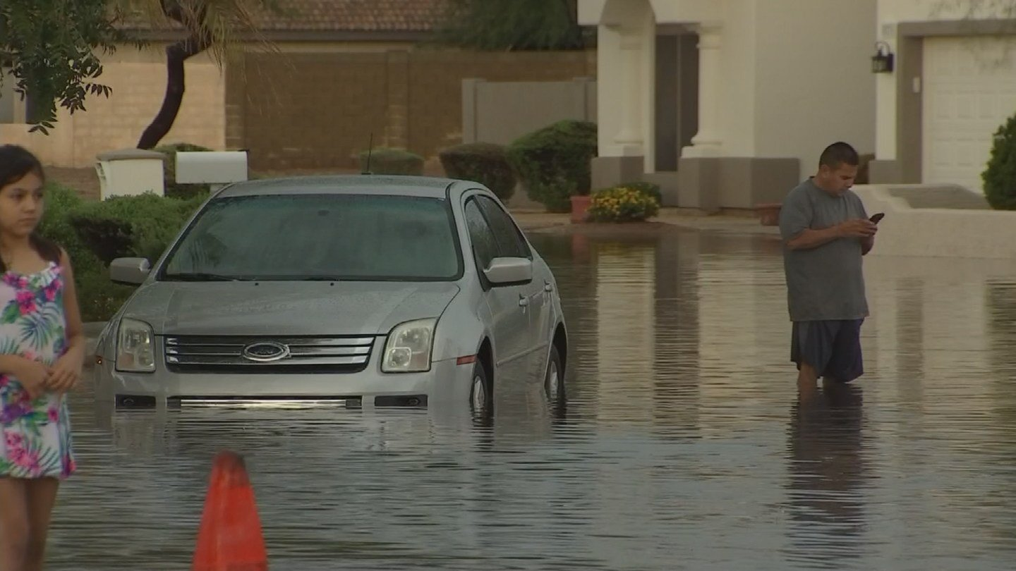 Residents hoped the water didn't make it to their homes. (Source: KPHO/KTVK)
