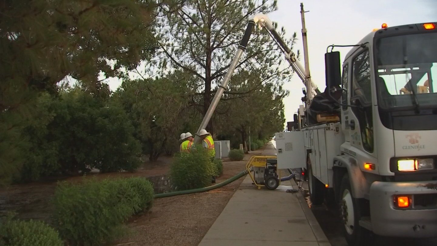 City crews spent hours pumping the water from the neighborhood. (Source: KPHO/KTVK)