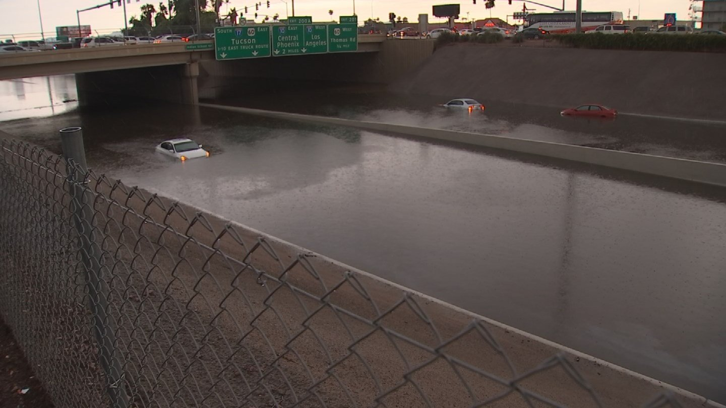 Flash flooding snarled rush hour traffic in Phoenix on August 2. Officials said Interstate 17 in Phoenix was closed at Indian School Road because of massive interchange flooding.  (Source: KPHO/KTVK)