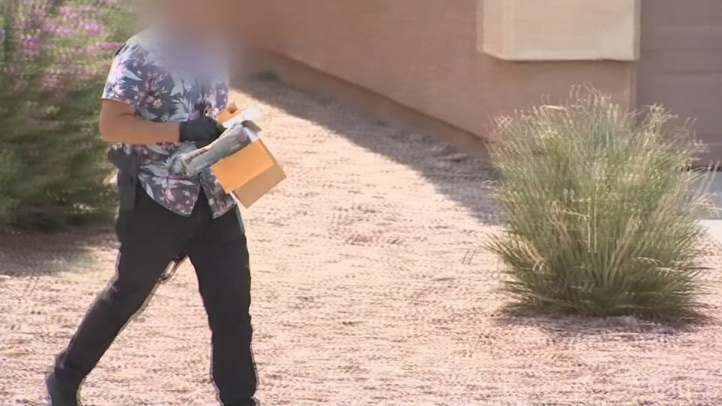 At least five plain-clothes detectives were seen going in and out of Wilson's home Thursday afternoon. (Source: KPHO/KTVK)