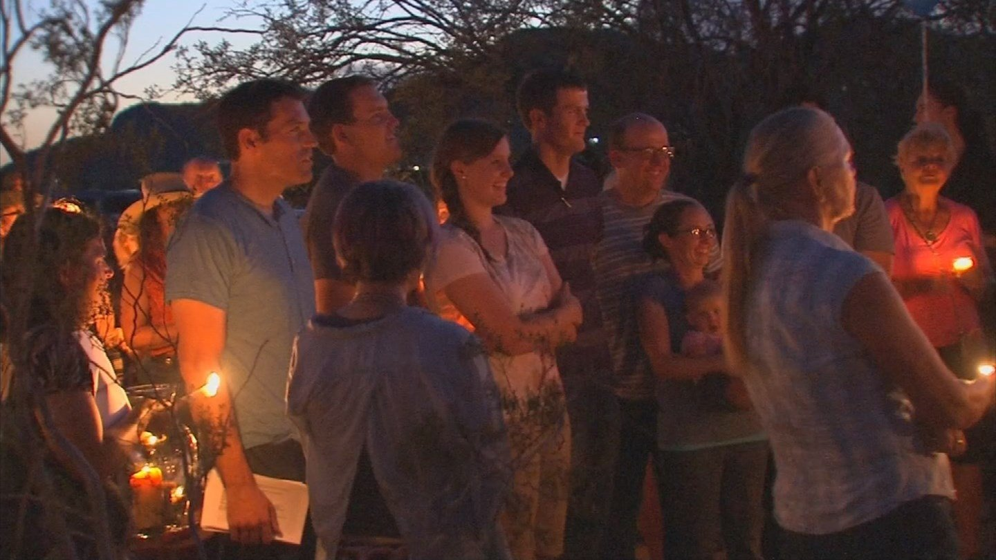 Dozens of friends and family packed together just as the sun was setting at the corner of Cloud Road and Central Avenue in Desert Hills. They were there to say goodbye to Dr. William Tryon, 61, andChristian Silaghi, 34. (Source: KPHO/KTVK)