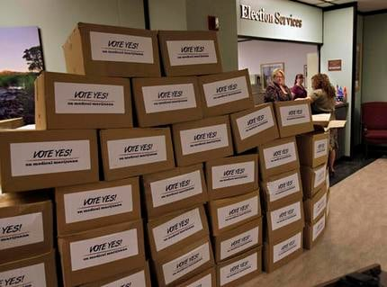 This April 14, 2010 file photo shows more than 100 boxes containing over 252,000 signatures collected by the Arizona Medical Marijuana Policy Project line at the Arizona Secretary of State's Office at the Capitol in Phoenix. (Source: AP photo/Matt York)