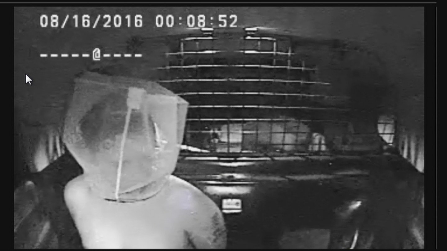 Despite the spit hood over his head, Miranda's words were clearly captured on video. (Glendale Police Dept.)