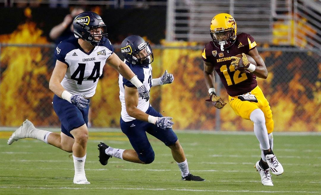 Northern Arizona's Jake Thomas (44) and Andrew Gose, middle, chase down Arizona State's Tim White (12) during the first half of an NCAA college football game Saturday, Sept. 3, 2016, in Tempe, Ariz. (AP Photo/Ross D. Franklin)
