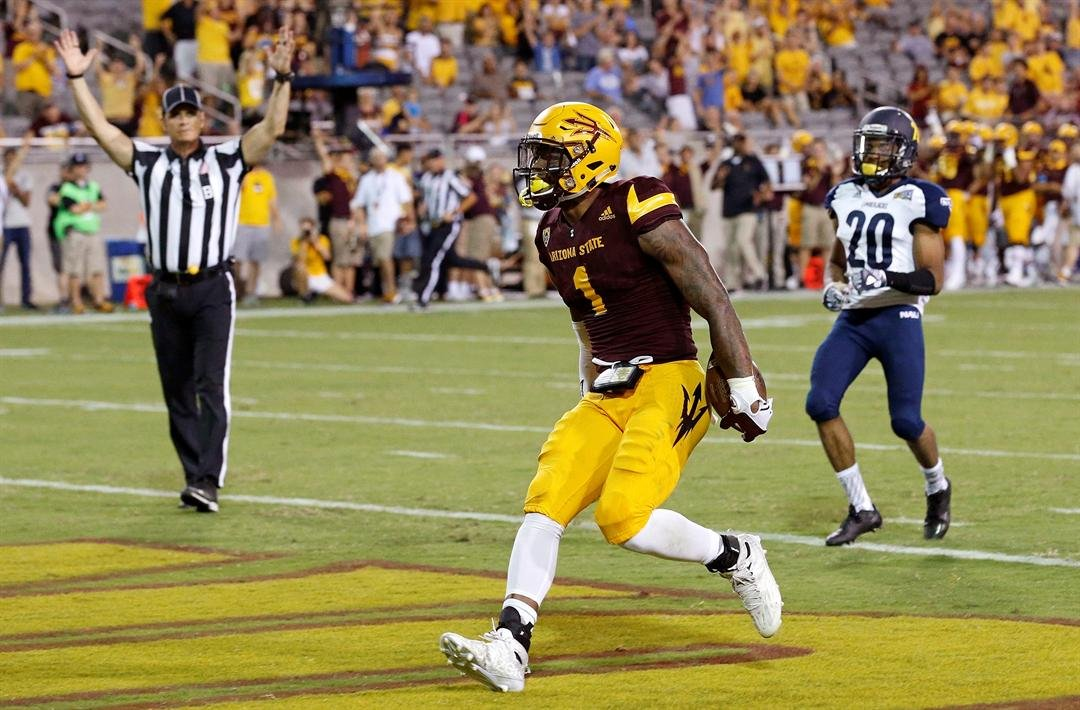 N'Keal Harry celebrates his fourth quarter TD in ASU's 44-13 win over NAU (AP Photo/Ross D. Franklin)