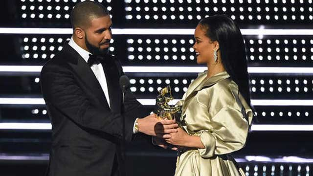 FILE - In this Aug. 28, 2016, file photo, Drake presents the Michael Jackson Video Vanguard Award to Rihanna at the MTV Video Music Awards. (Photo by Charles Sykes/Invision/AP, File)