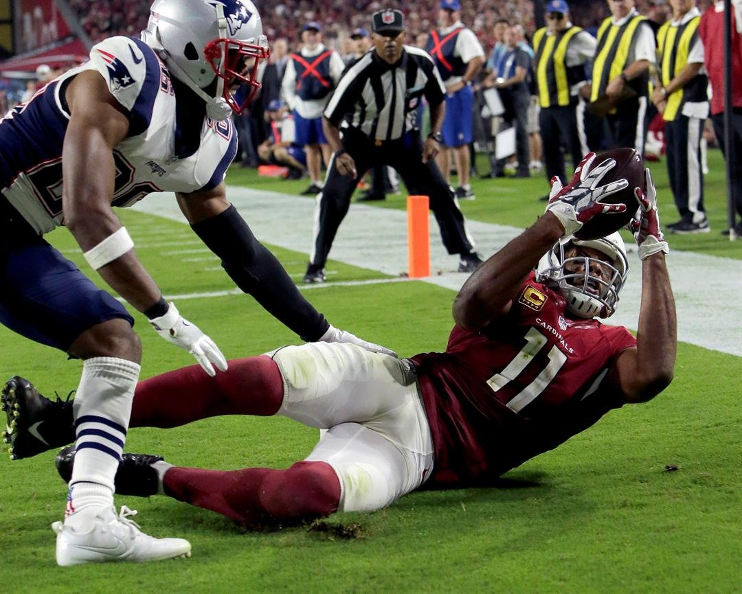 Arizona Cardinals wide receiver Larry Fitzgerald (11) catches his career 100th touchdown pass during the second half of an NFL football game, Sunday, Sept. 11, 2016, in Glendale. (AP Photo/Rick Scuteri)