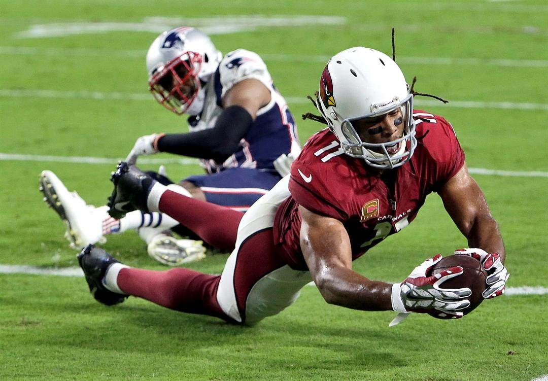 Short-handed Patriots hang on to defeat Cardinals