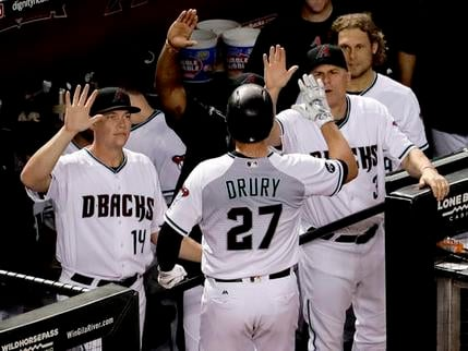 Arizona Diamondbacks' Brandon Drury (27) is greeted in the dugout after hitting a solo home run against the Colorado Rockies during the fifth inning of a baseball game, Tuesday, Sept. 13, 2016, in Phoenix. (AP Photo/Matt York)