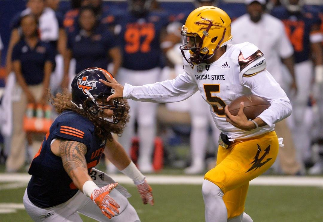 ASU QB Manny Wilkins stiff arms a UTSA defender during the Sun Devils' 32-28 victory (AP Photo/Darren Abate)
