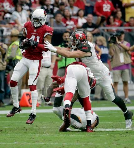 Arizona Cardinals defensive back Marcus Cooper (41) intecepts a pass for a touchdown as Tampa Bay Buccaneers tight end Brandon Myers (82) defends during the second half, Sunday, Sept. 18, 2016, in Glendale, Ariz.  (AP Photo/Rick Scuteri)