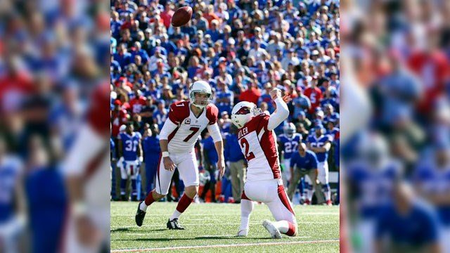 Arizona Cardinals holder Drew Butler can't handle a high snap in front of kicker Chandler Catanzaro (7) during the second half of an NFL football game against the Buffalo Bills on Sunday, Sept. 25, 2016. (Source: AP Photo/Bill Wippert)