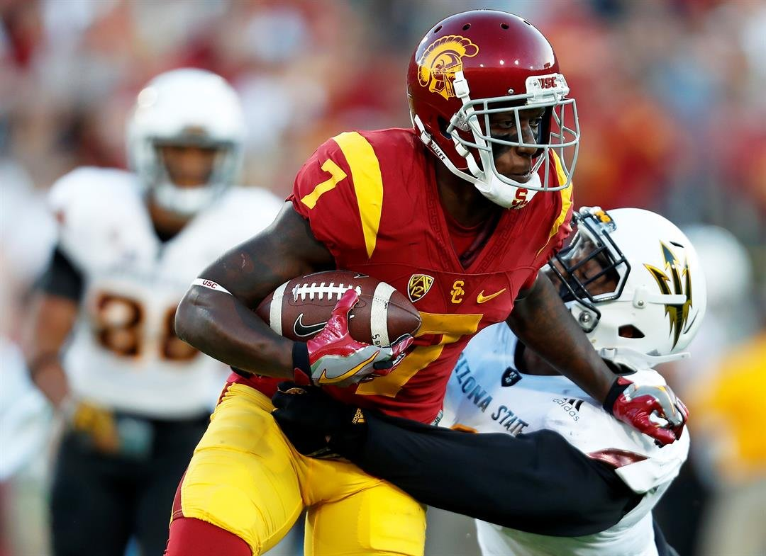 Southern California wide receiver Steven Mitchell Jr. (7) runs the ball against Arizona State defensive lineman JoJo Wicker (1) during the first half of an NCAA college football game Saturday, Oct. 1, 2016, in Los Angeles. (AP Photo/Ryan Kang)