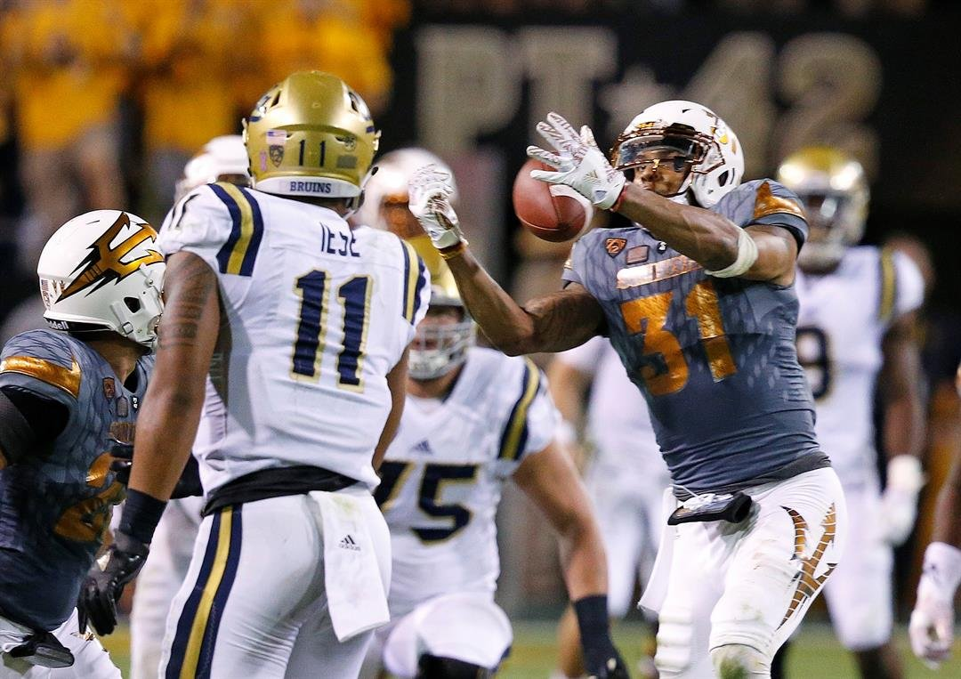Marcus Ball hauls in an interception against UCLA (AP Photo/Ross D. Franklin)