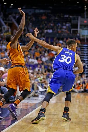Golden State Warriors guard Stephen Curry (30) shoves Phoenix Suns guard Brandon Knight (11) for a foul during the first half of an NBA basketball game Sunday, Oct. 30, 2016, in Phoenix. (AP Photo/Ross D. Franklin)