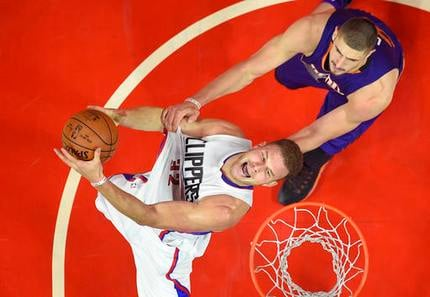 Los Angeles Clippers forward Blake Griffin, left, is fouled by Phoenix Suns center Alex Len, of Ukraine, as he shoots during the second half of an NBA basketball game, Monday, Oct. 31, 2016, in Los Angeles.  (AP Photo/Mark J. Terrill)