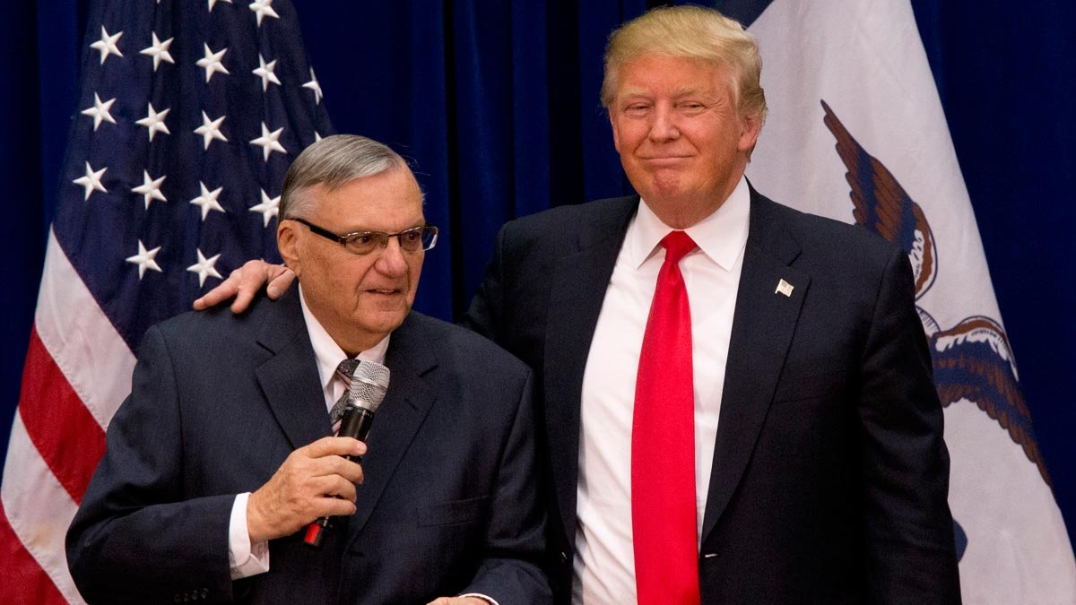 In this Jan. 26, 2016, photo, now President-elect Donald Trump  is joined by Maricopa County Sheriff Joe Arpaio at a campaign event at the Roundhouse Gymnasium in Marshalltown, Iowa. (Source: AP Photo/Mary Altaffer, File)