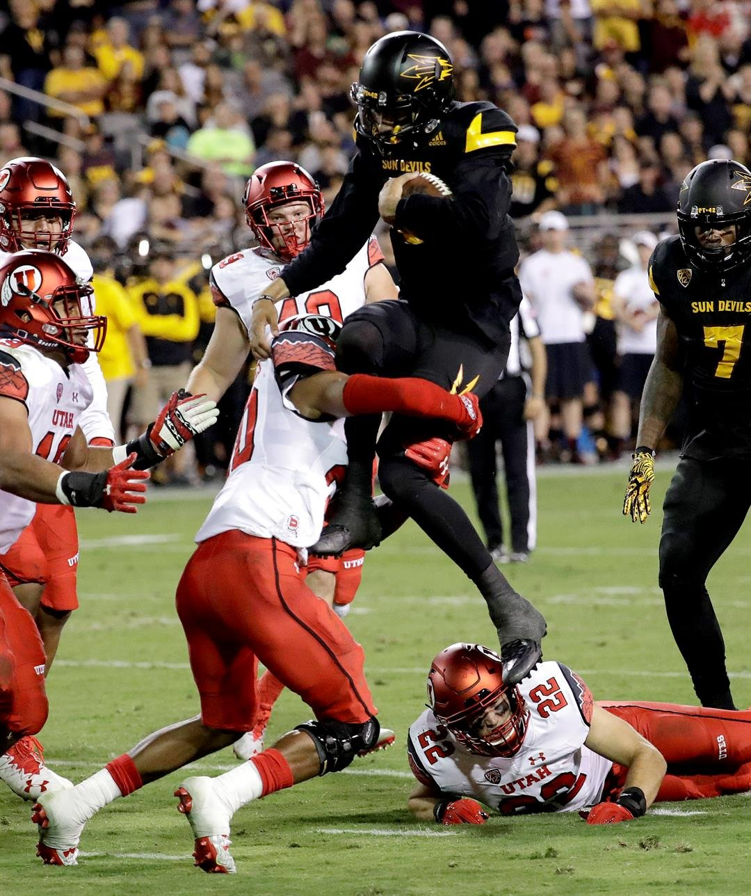 Arizona State quarterback Manny Wilkins is stopped short of the goal line by Utah defensive back Marcus Williams (20) during the first half of an NCAA college football game, Thursday, Nov. 10, 2016, in Tempe, Ariz. (AP Photo/Matt York)