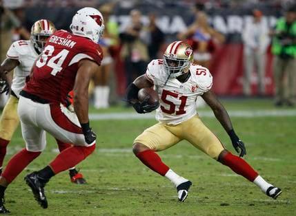 San Francisco 49ers inside linebacker Gerald Hodges (51) returns an interception as Arizona Cardinals tight end Jermaine Gresham (84) pursues, Sunday, Nov. 13, 2016, in Glendale, Ariz. (AP Photo/Ross D. Franklin)