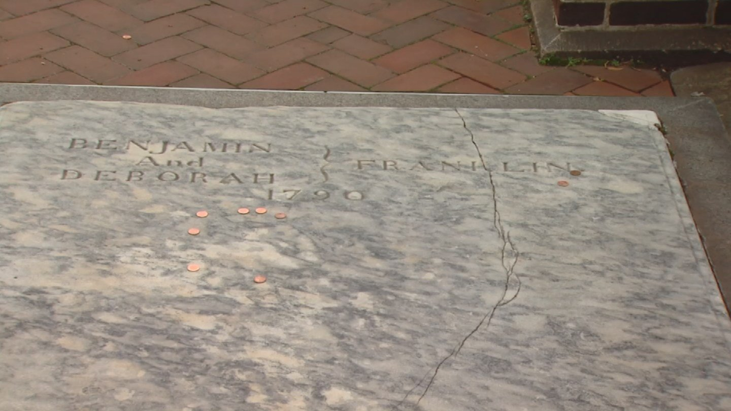Benjamin Franklin's grave pitted from pennies needs makeover