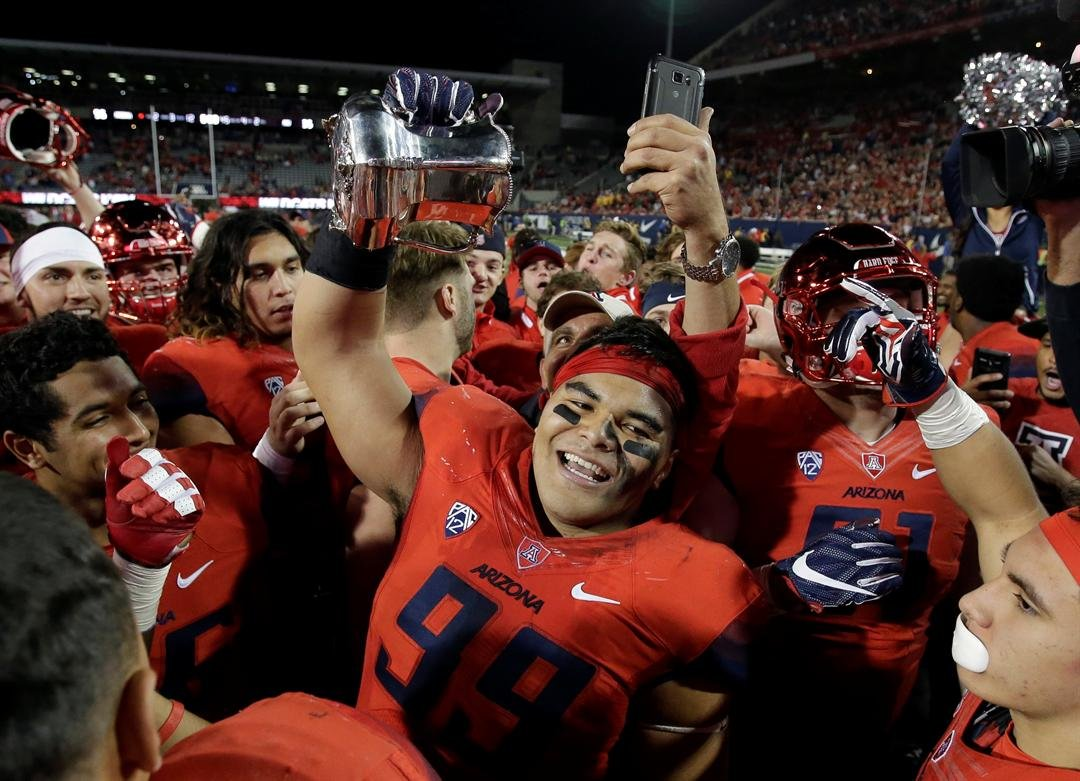 The Arizona Wildcats celebrate their victory over Arizona State (AP Photo/Rick Scuteri)
