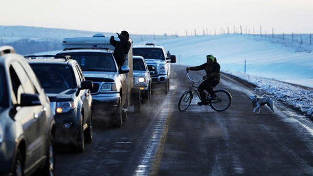 A line of the cars wait to enter the Oceti Sakowin camp where people have gathered to protest the Dakota Access oil pipeline in Cannon Ball, N.D., Saturday, Dec. 3. (AP Photo/David Goldman)