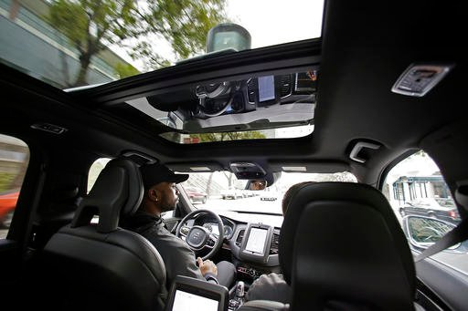 In this Tuesday, Dec. 13, 2016, file photo, Devin Greene sits in the front seat of an Uber driverless car during a test drive in San Francisco. (Source: AP Photo/Eric Risberg, File)