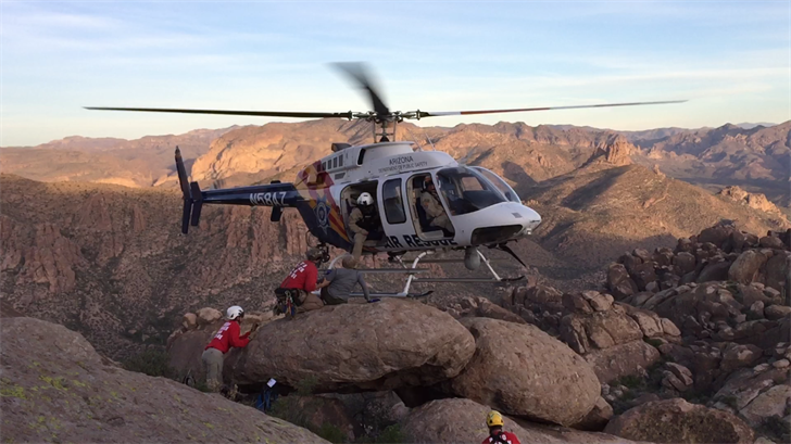 The pilot delicately balanced his aircraft with one skid on rock, a maneuver called a one skid ingress. (Source: Arizona Department of Public Safety)