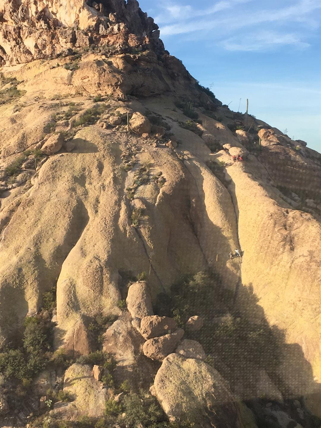 Four Pinal County Sheriff's Office Search and Rescue volunteers helped the hikers to a less steep area where the helicopter could pick them up. (Source: Arizona Department of Public Safety)